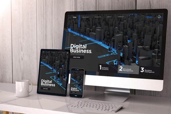 Digital generated devices on desktop, responsive digital business website on screen. All screen graphics are made up. 3d rendering.