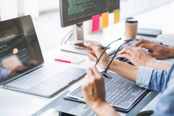 Software programmer engineering coding development in user data  technology.